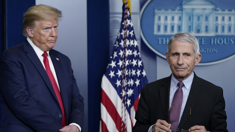Dr. Anthony Fauci and Donald Trump in a press statement