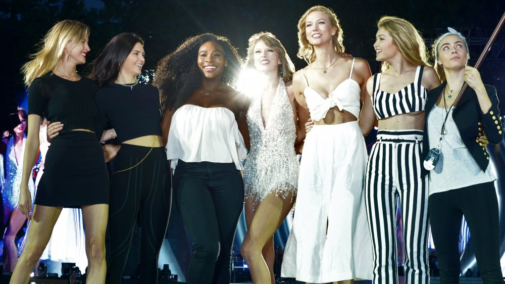 Martha Hunt Kendall Jenner Serena Williams Taylor Swift Karlie Kloss Gigi Hadid Cara Delevingne on stage at a 1989 Tour show in 2015