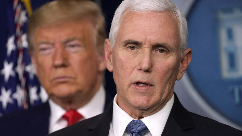 Mike Pence in the foreground of Donald Trump