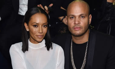LONDON, ENGLAND - DECEMBER 02: Melanie Brown and Stephen Belafonte attend the 2014 Victoria's Secret Fashion Show - Show Front Row & Pre-Cocktail Reception at Earl's Court exhibition centre on December 2, 2014 in London, England. (Photo by Dimitrios Kambouris/Getty Images for Victoria's Secret)