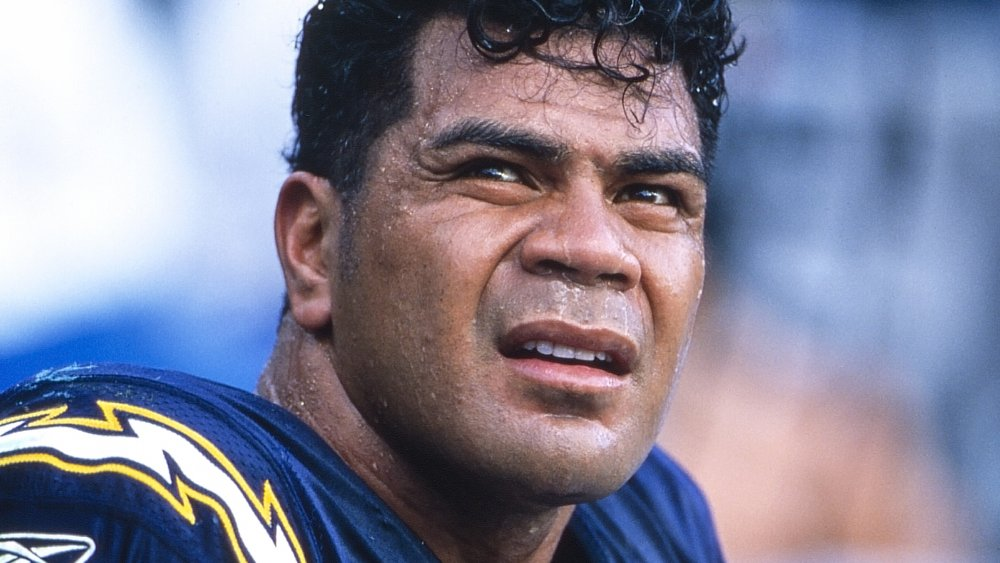 Junior Seau looking off to the side with a serious expression during a game