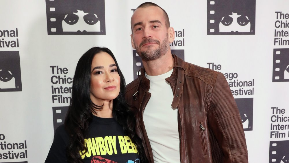 CM Punk and AJ Lee attend the premiere of Girl on the Third Floor