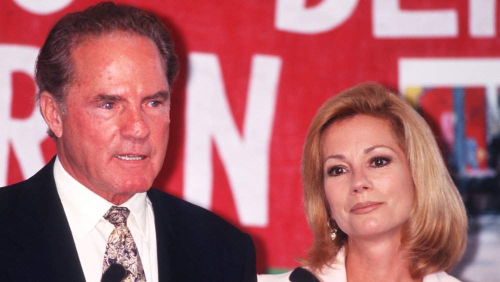 Frank Gifford and Kathie Lee Gifford speaking, both looking serious