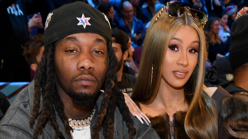 Offset in a grey-and-white blazer and black hat, Cardi B in a black-and-fur outfit with sunglasses on her head