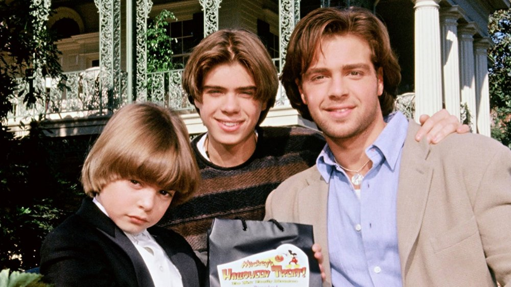 Andrew Lawrence, Matthew Lawrence, and Joey Lawrence pose at Disneyland in 1995