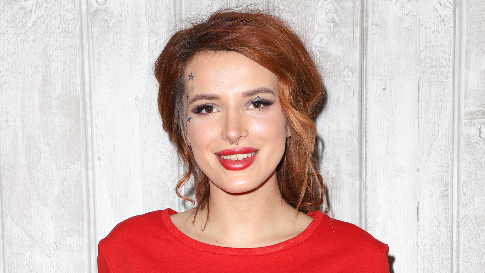 Bella Thorne smiling with red hair