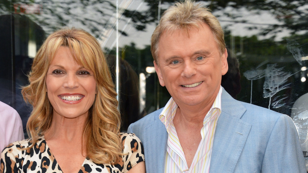 Vanna White and Pat Sajak smiling