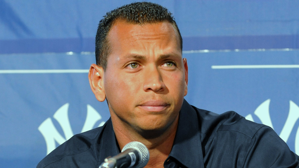 Alex Rodriguez furrowing his brow at a press conference