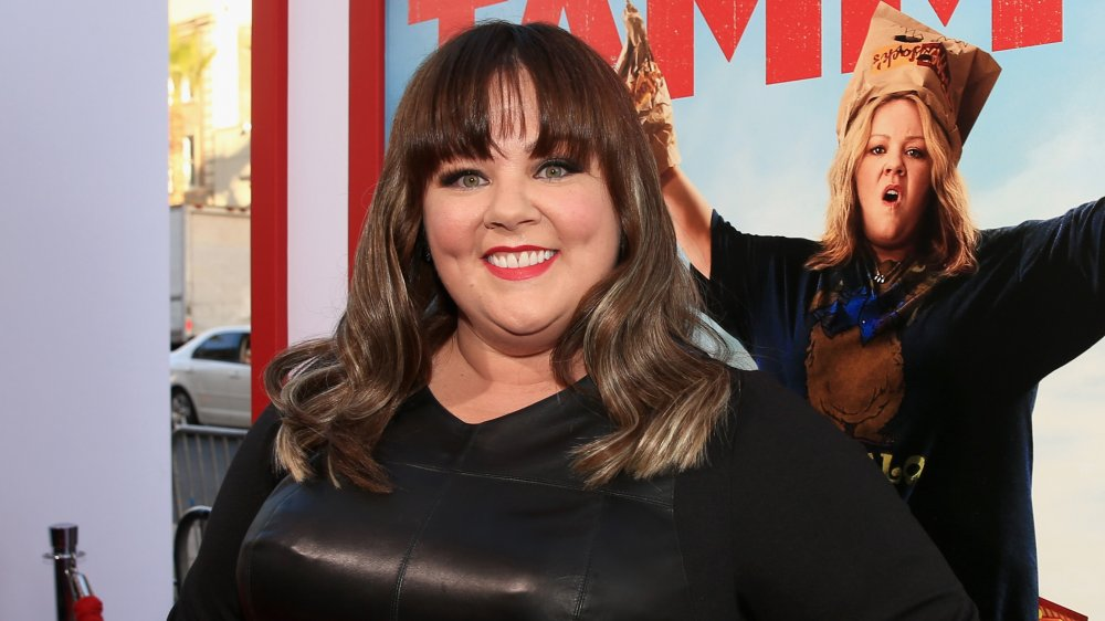 Melissa McCarthy with bangs, smiling at the Tammy premiere