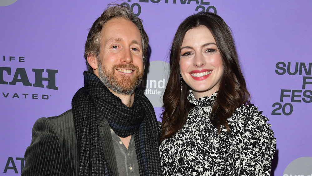 Anne Hathaway and Adam Shulman on a red carpet