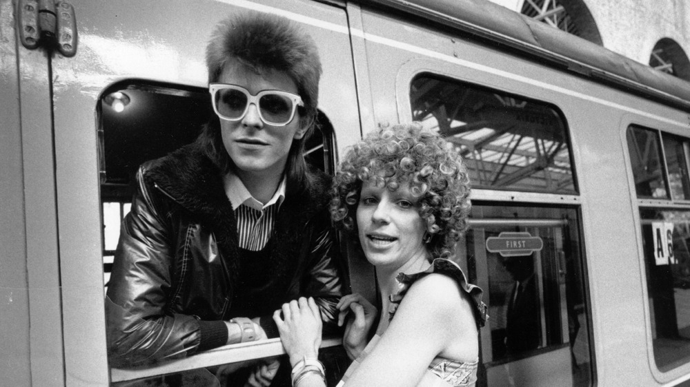 David Bowie and his first wife Angie at a train station