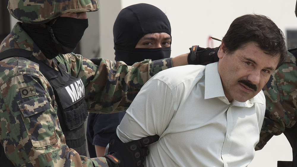 El Chapo taken through Mexican International Airport after his arrest, February 2014