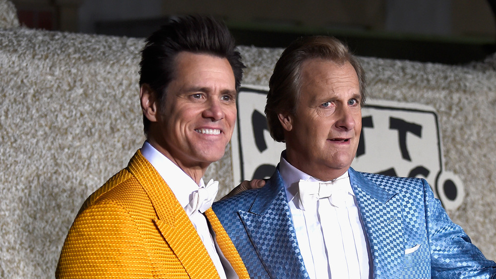 Jim Carrey and Jeff Daniels pose together at the premiere of Dumber and Dumber To