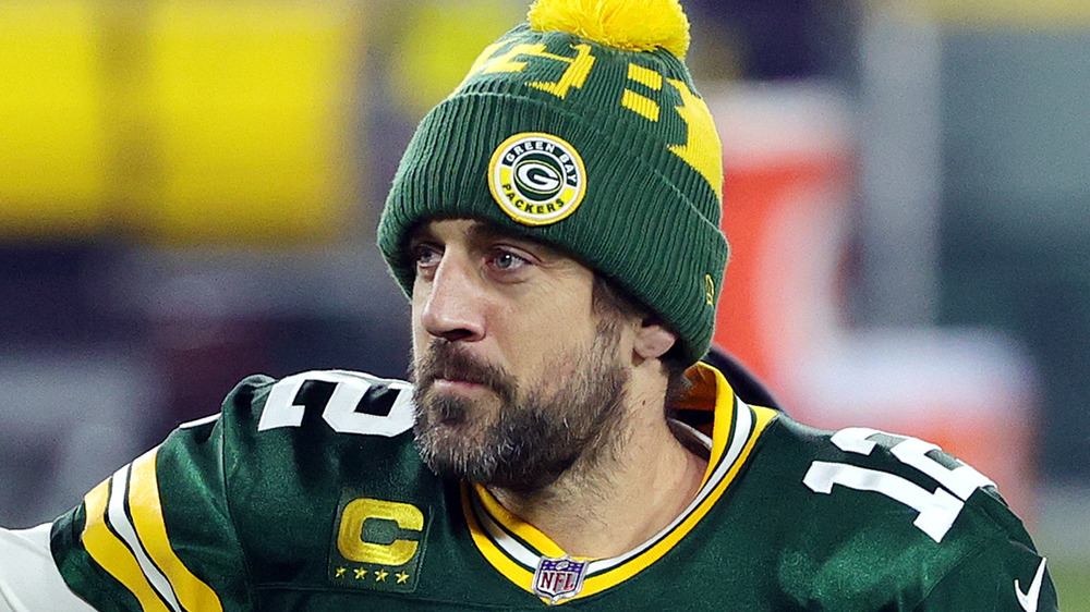 Aaron Rodgers smiling on the field