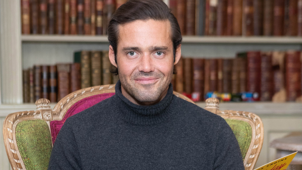Spencer Matthews with a cheeky grin
