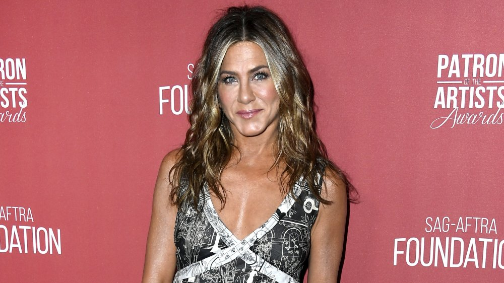 Jennifer Aniston smiling at the Patron of the Artists Awards
