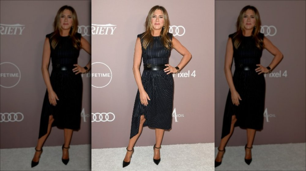 Jennifer Aniston posing with one hand on her hip at the 2019 Power of Women Gala