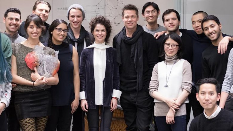 Neri Oxman and Brad Pitt pose with a group
