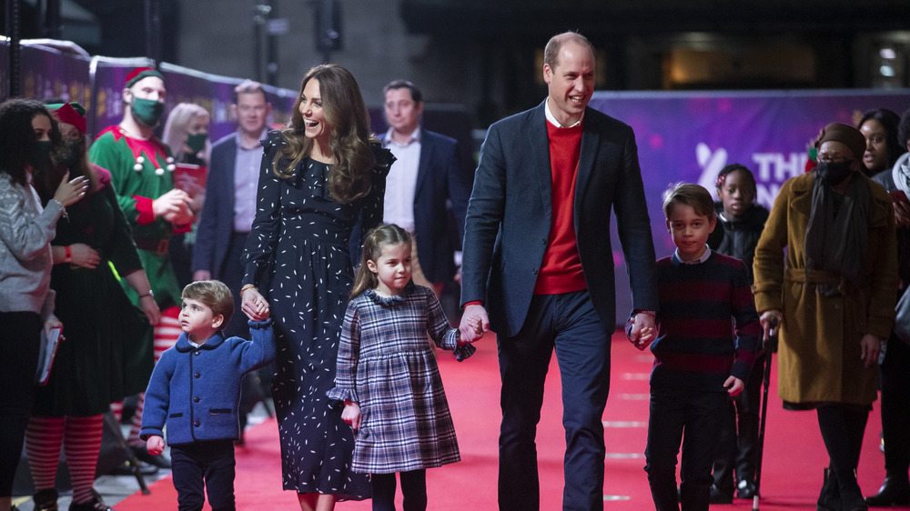 Kate Middleton and Prince William walk with their children