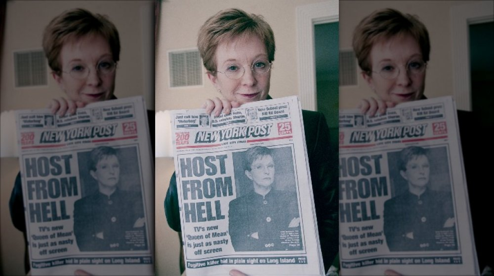 Television presenter Anne Robinson holding up a news paper