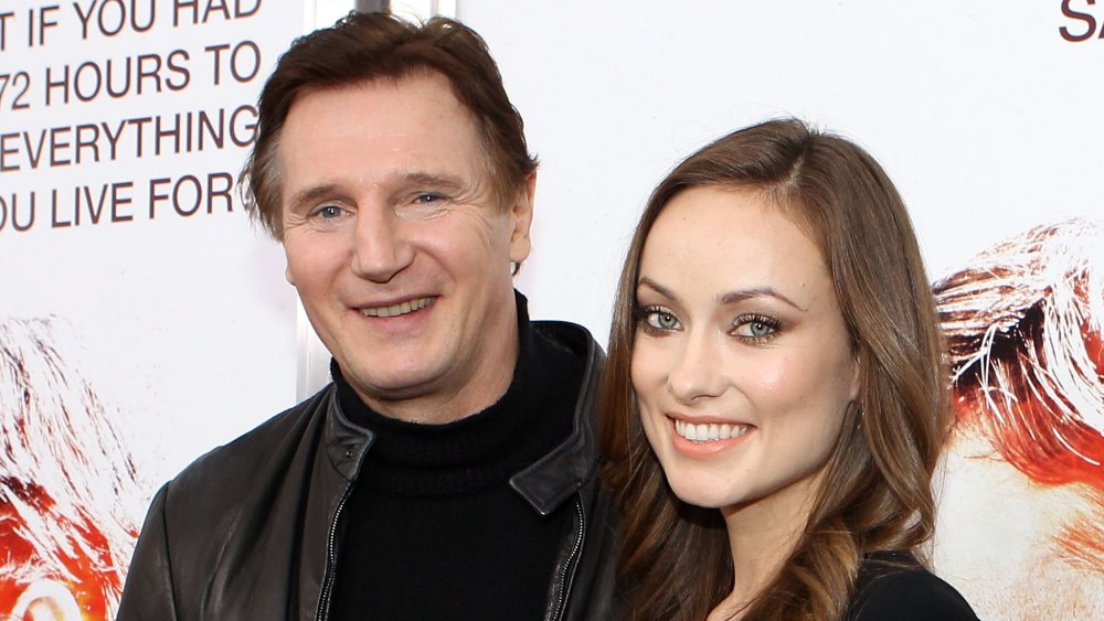 Liam Neeson and Olivia Wilde at the premiere of The Next Three Days